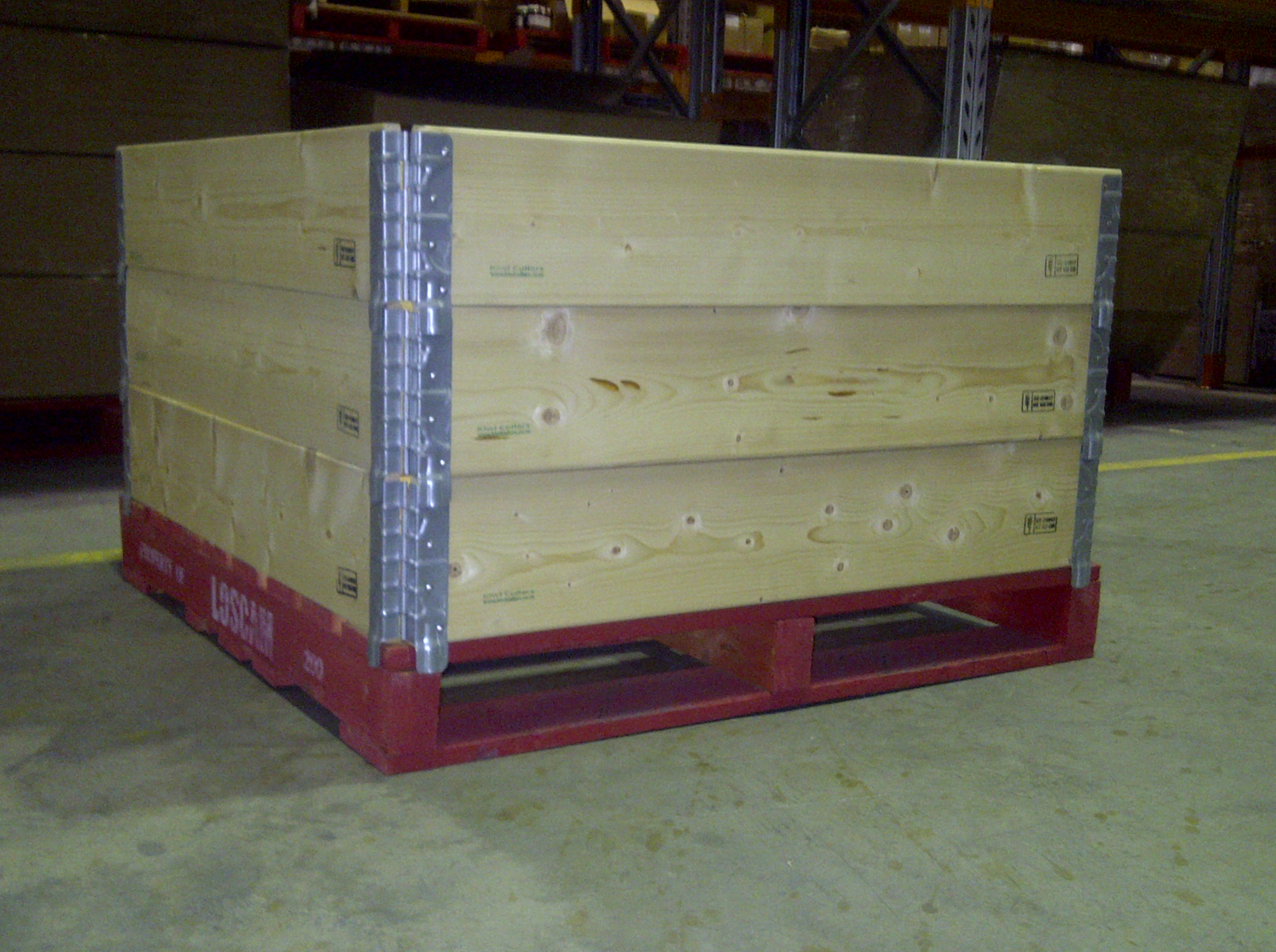 3 pallet collars on a shipping pallet.